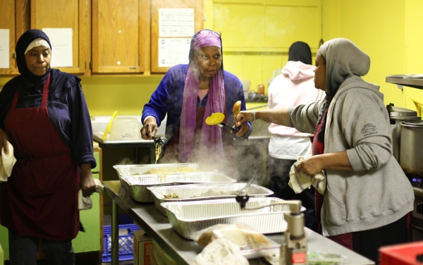 On a first Saturday after Thanksgiving,  African American Muslim women, including (from left) Fatima Markham, Ayishiah Ramzah and Nurah Petross  cook from scratch a hot lunch meal to local residents at the soup kitchen of the Muslim Center of  Detroit.   The soup kitchen in the building on Davison Avenue in Detroit is open every Saturday for lunch.  Saturday, Nov. 26, 2011.  Photo by Marcin Szczepanski